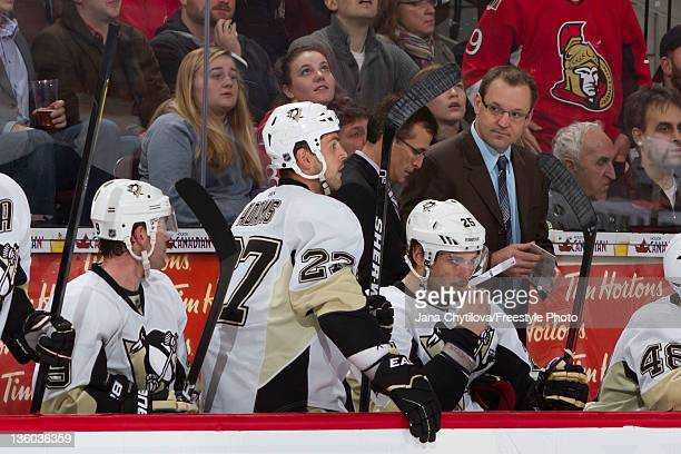 Head coach Dan Bylsma of the Pittsburgh Penguins looks on from the bench during an NHL game against the Ottawa Senators at Scotiabank Place on...