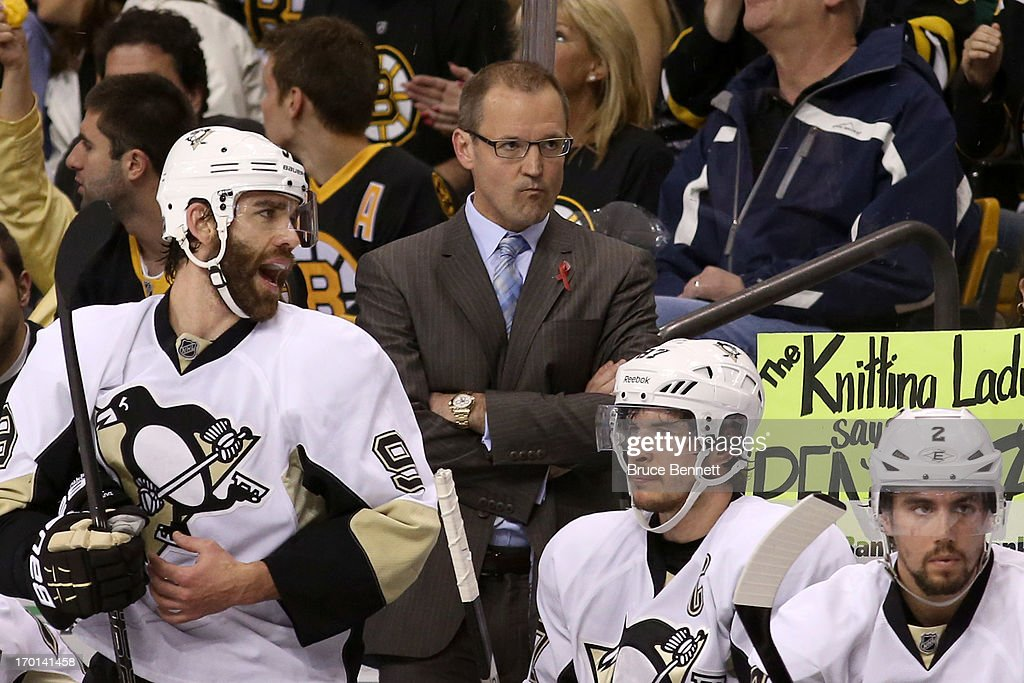 Head coach Dan Bylsma of the Pittsburgh Penguins looks on from the bench with his players Pascal Dupuis #9, Sidney Crosby #87 and Matt Niskanen #2 in the first period against the Boston Bruins in Game Four of the Eastern Conference Final during the 2013 NHL Stanley Cup Playoffs at the TD Garden on June 7, 2013 in Boston, United States.