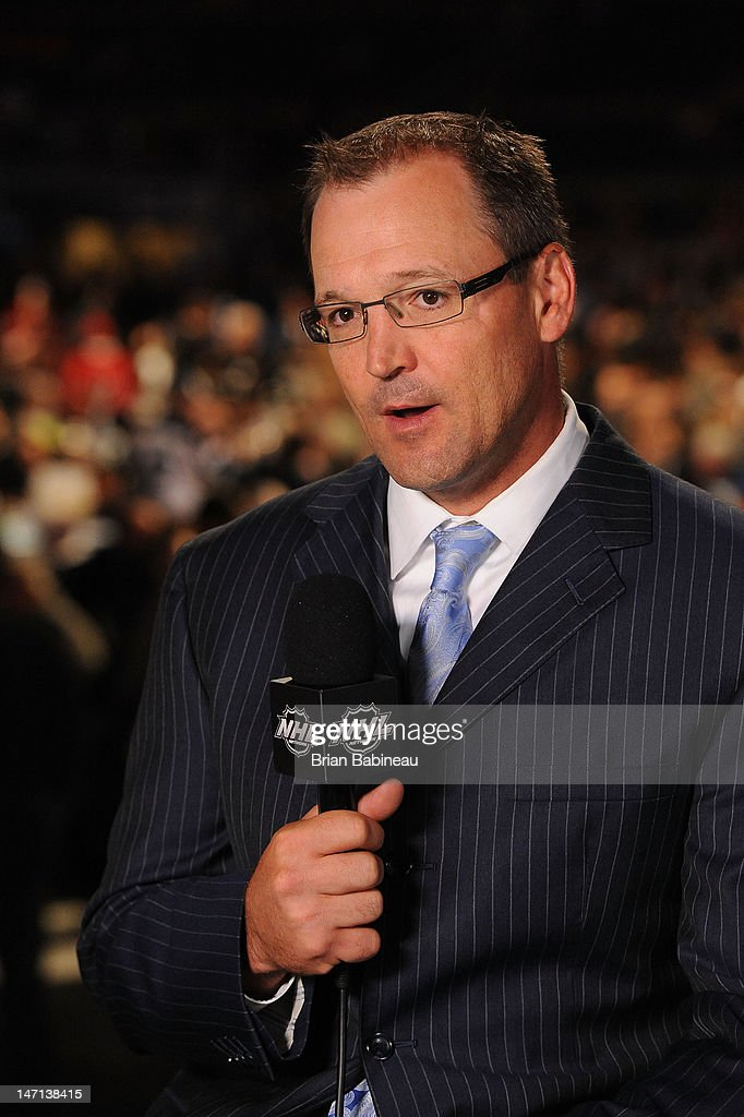 Head coach Dan Bylsma of the Pittsburgh Penguins provides commentary during Rounds 2-7 of the 2012 NHL Entry Draft broadcast at Consol Energy Center on June 23, 2012 in Pittsburgh, Pennsylvania.