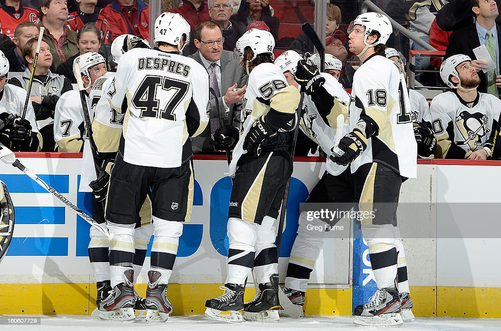 Head coach <a gi-track='captionPersonalityLinkClicked' href=/galleries/search?phrase=Dan+Bylsma&family=editorial&specificpeople=2221854 ng-click='$event.stopPropagation()'>Dan Bylsma</a> of the Pittsburgh Penguins talks to his team during a timeout against the Washington Capitals at Verizon Center on February 3, 2013 in Washington, DC.