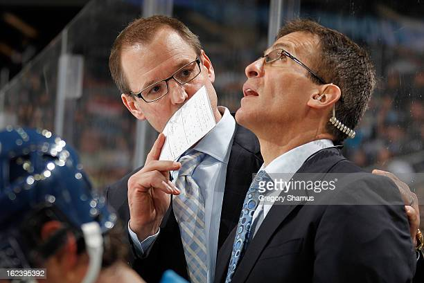 Head Coach Dan Bylsma of the Pittsburgh Penguins talks with Assistant Coach Tony Granato during the game against the Florida Panthers on February 22...