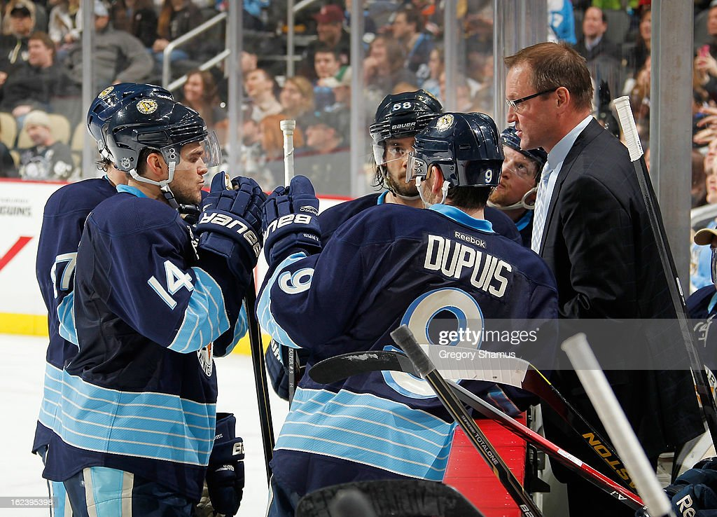Head Coach Dan Bylsma of the Pittsburgh Penguins talks with Chris Kunitz #14 and Pascal Dupuis #9 during a timeout against the Florida Panthers on February 22, 2013 at Consol Energy Center in Pittsburgh, Pennsylvania.