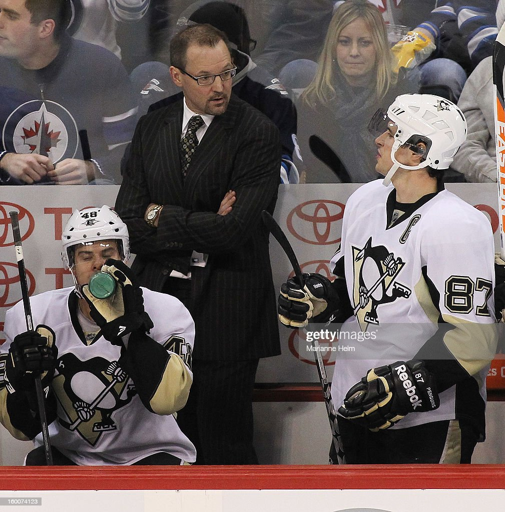 Head coach <a gi-track='captionPersonalityLinkClicked' href=/galleries/search?phrase=Dan+Bylsma&family=editorial&specificpeople=2221854 ng-click='$event.stopPropagation()'>Dan Bylsma</a> of the Pittsburgh Penguins talks with <a gi-track='captionPersonalityLinkClicked' href=/galleries/search?phrase=Sidney+Crosby&family=editorial&specificpeople=212781 ng-click='$event.stopPropagation()'>Sidney Crosby</a> #87 on the bench during third-period action in a game against the Winnipeg Jets on January 25, 2013 at the MTS Centre in Winnipeg, Manitoba, Canada.