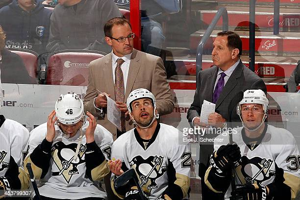 Head Coach Dan Bylsma of the Pittsburgh Penguins watches the action with Assistant Coach Jacques Martin against the Florida Panthers at the BBT...