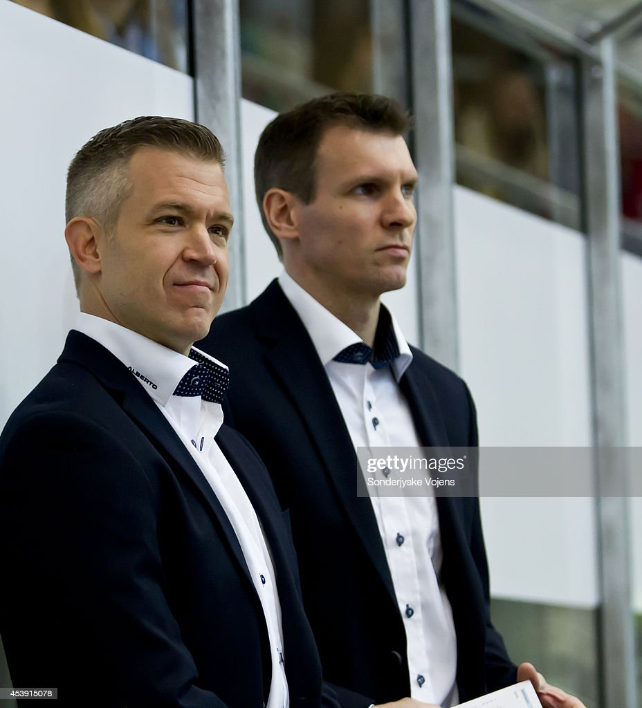 Head Coach Dan Ceman and assistant coach Christopher Straube of Sonderjyske look on during the Champions Hockey League group stage game between Sonderjyske Vojens and IFK Helsinki on August 21, 2014 in Vojens, Denmark.