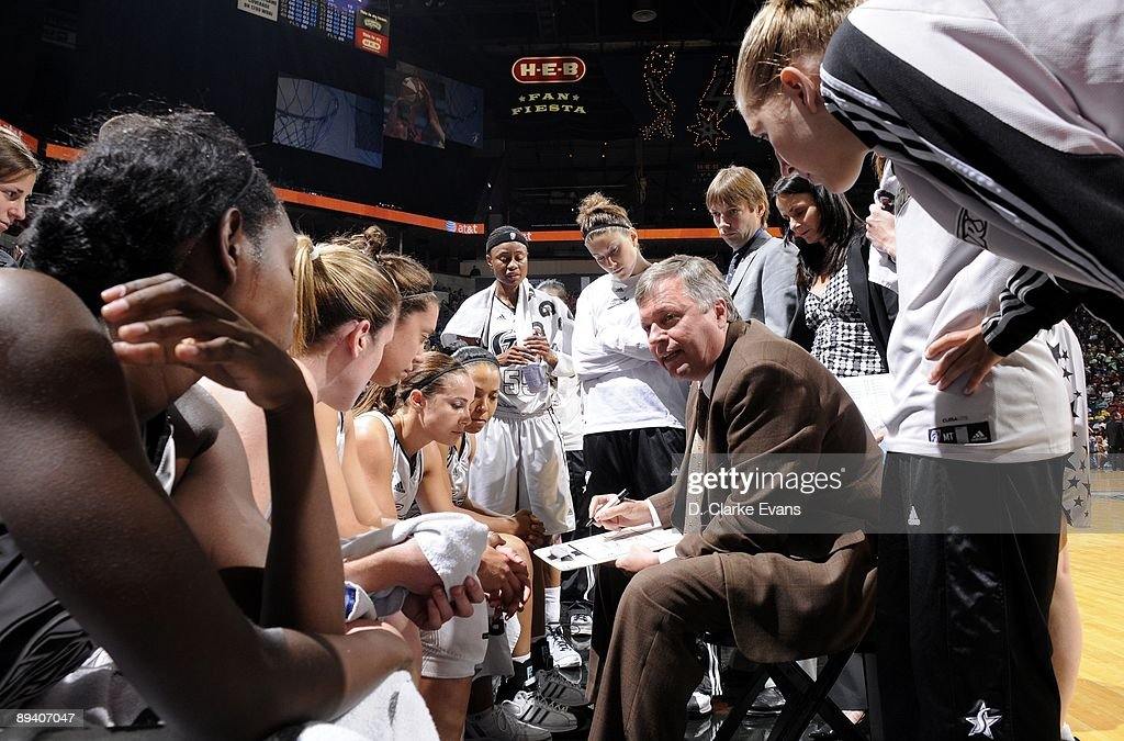 Head coach Dan Hughes of the San Antonio Silver Stars talks to his team during a break in the action against the Indiana Fever at ATT Center on July...