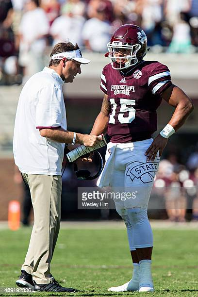 Head Coach Dan Mullen and Dak Prescott of the Mississippi State Bulldogs talk during a timeout against the Northwestern State Demons at Davis Wade...