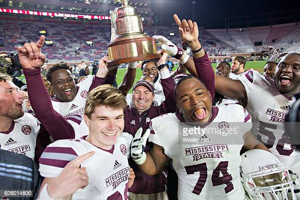 Head Coach Dan Mullen of the Mississippi State Bulldogs celebrates with his team after a game against the Mississippi Rebels at VaughtHemingway...