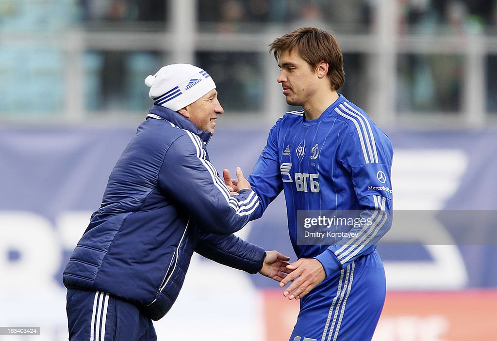 Head coach Dan Petrescu of FC Dynamo Moscow celebrates with Alexandru Epureanu after winning Russian Premier League match between FC Dynamo Moscow and FC Lokomotiv Moscow at the Arena Khimki Stadium on March 09, 2013 in Khimki, Russia.