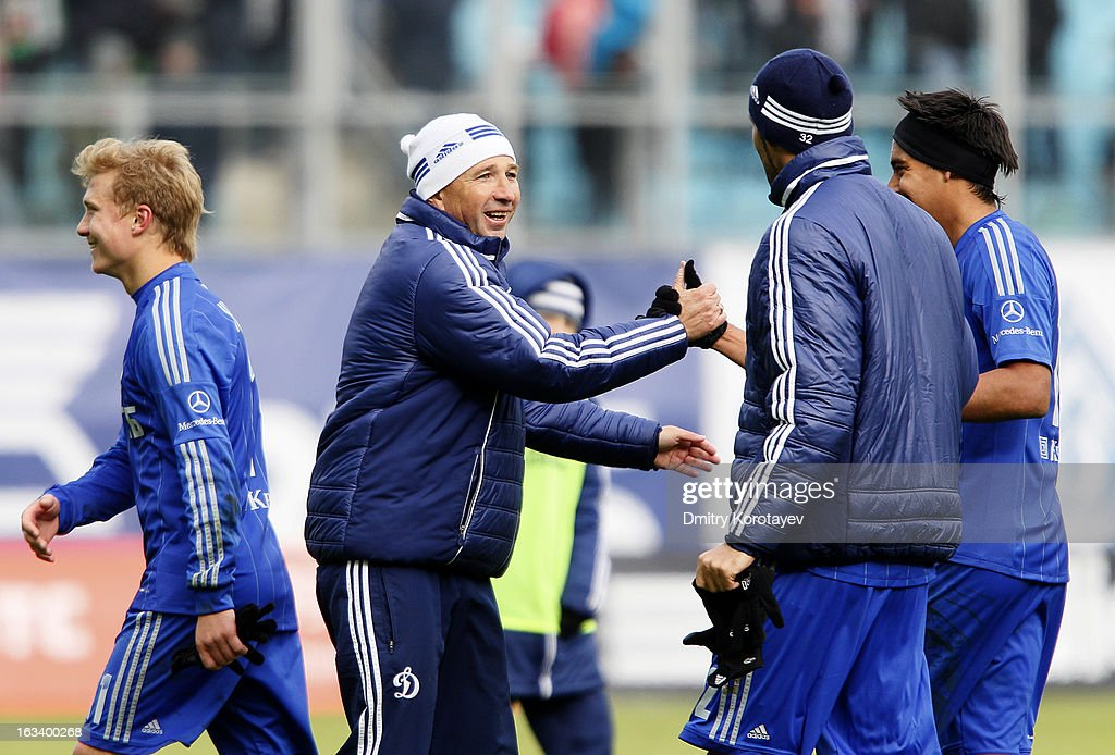 Head coach Dan Petrescu of FC Dynamo Moscow celebrates with players after winning their Russian Premier League match against FC Lokomotiv Moscow at the Arena Khimki Stadium on March 09, 2013 in Khimki, Russia.
