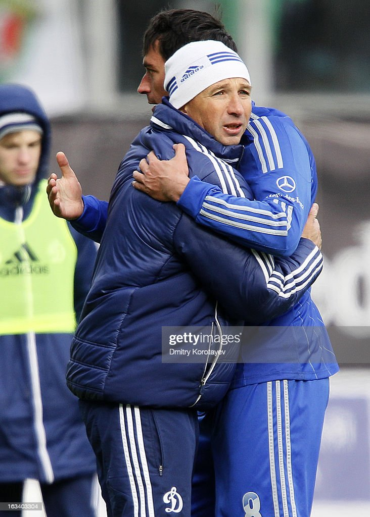 Head coach Dan Petrescu of FC Dynamo Moscow celebrates with Sergei Davydov after winning Russian Premier League against FC Lokomotiv Moscow at the Arena Khimki Stadium on March 09, 2013 in Khimki, Russia.