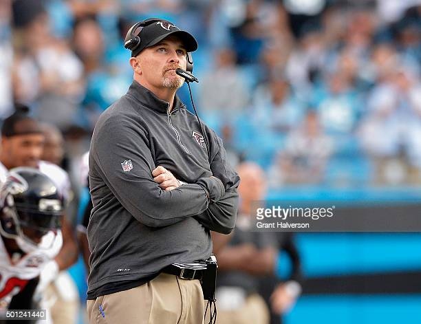 Head coach Dan Quinn of the Atlanta Falcons looks up at the scoreboard during the fourth quarter of their game against the Carolina Panthers at Bank...