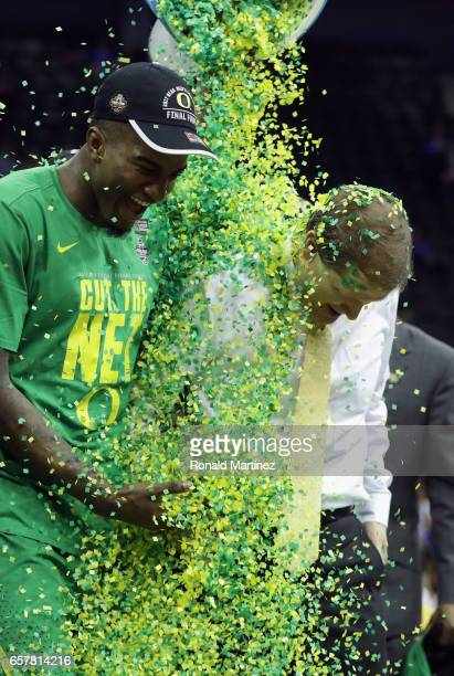 Head coach Dana Altman of the Oregon Ducks is dunked with confetti after defeating the Kansas Jayhawks 7460 during the 2017 NCAA Men's Basketball...