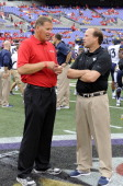 Head coach Dana Holgorsen of the West Virginia Mountaineers talks with head coach Randy Edsall of the Maryland Terrapins before the game at MT Bank...