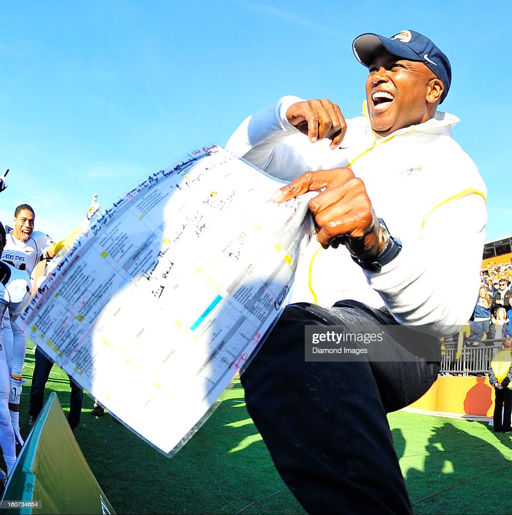 Head coach Darrell Hazell of the Kent State Golden Flashes celebrates after a game with the Bowling Green Falcons at Dolt L. Perry Stadium in Bowling Green, Ohio. The Kent State Golden Flashes won 31-24.