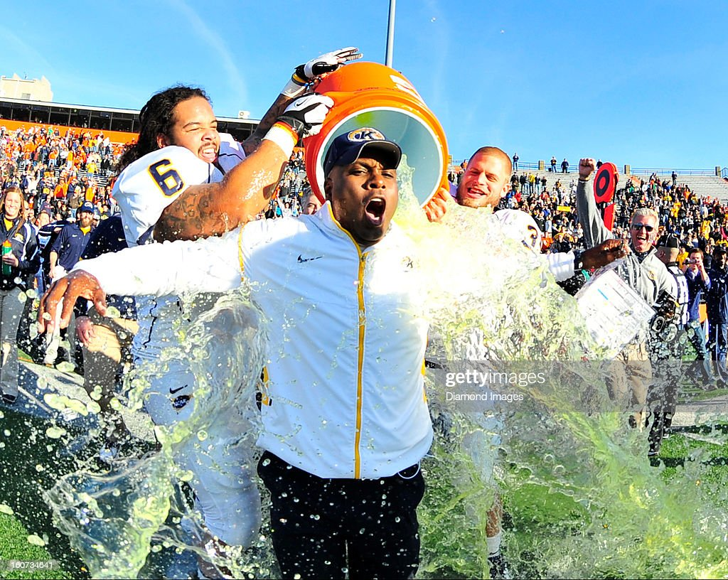 Head coach Darrell Hazell of the Kent State Golden Flashes receives a Gatorade bath from defensive linemen Dana Brown Jr. after a game with the Bowling Green Falcons at Dolt L. Perry Stadium in Bowling Green, Ohio. The Kent State Golden Flashes won 31-24.