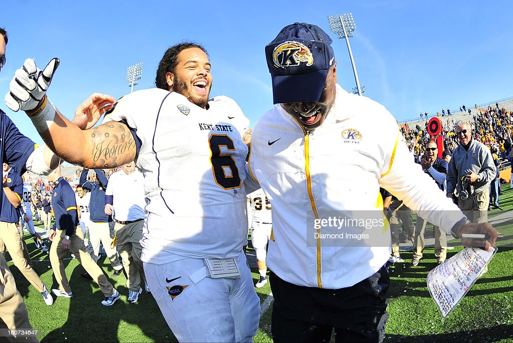 Head coach Darrell Hazell of the Kent State Golden Flashes smiles after a Gatorade bath from defensive linemen Dana Brown Jr. after a game with the Bowling Green Falcons at Dolt L. Perry Stadium in Bowling Green, Ohio. The Kent State Golden Flashes won 31-24.