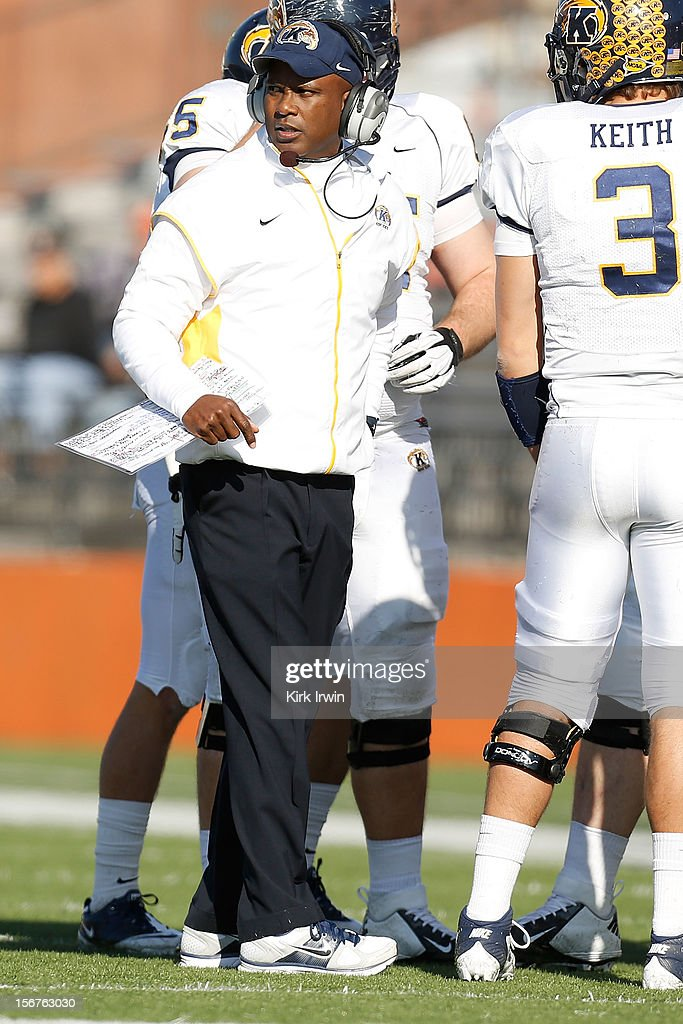 Head Coach Darrell Hazell of the Kent State Golden Flashes speaks with his team during a timeout in the game against the Bowling Green Falcons on November 17, 2012 at Doyt Perry Stadium in Bowling Green, Ohio.