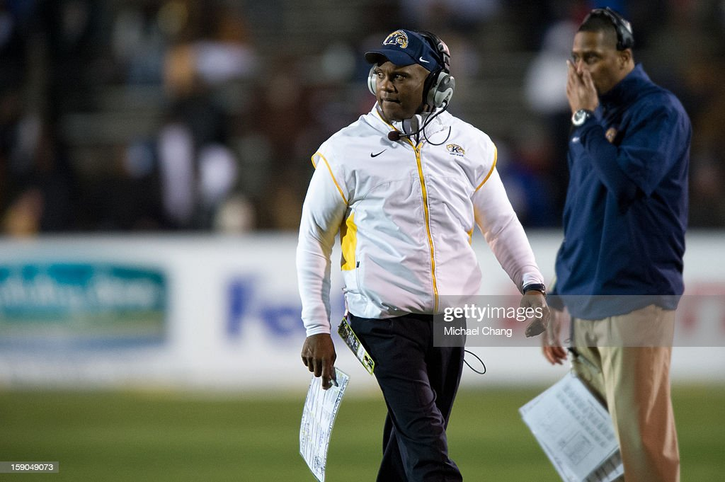 Head coach Darrell Hazell of the Kent State Golden Flashes watches the referee while they discuss a penalty during their game against the Arkansas State Red Wolves on January 6, 2013 at Ladd-Peebles Stadium in Mobile, Alabama. At halftime Arkansas State leads Kent State 14-10.