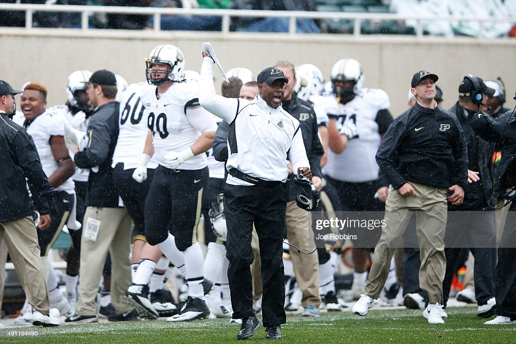 Head coach <a gi-track='captionPersonalityLinkClicked' href=/galleries/search?phrase=Darrell+Hazell&family=editorial&specificpeople=7730325 ng-click='$event.stopPropagation()'>Darrell Hazell</a> of the Purdue Boilermakers celebrates after a touchdown in the second half against the Michigan State Spartans at Spartan Stadium on October 3, 2015 in East Lansing, Michigan.