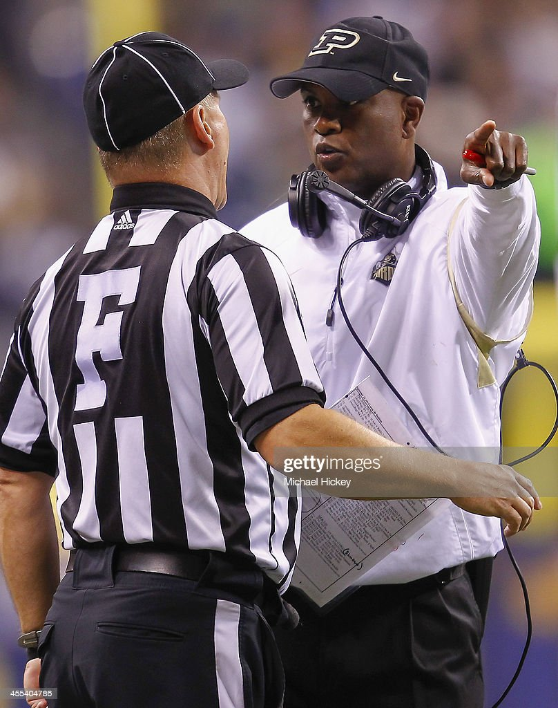 Head coach Darrell Hazell of the Purdue Boilermakers talks to an official during the game against the Notre Dame Fighting Irish at Lucas Oil Stadium on September 13, 2014 in Indianapolis, Indiana. Notre Dame defeated Purdue 30-14.