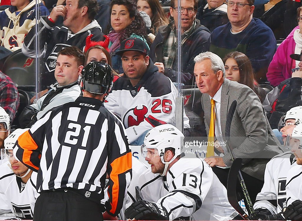 Head coach <a gi-track='captionPersonalityLinkClicked' href=/galleries/search?phrase=Darryl+Sutter&family=editorial&specificpeople=209125 ng-click='$event.stopPropagation()'>Darryl Sutter</a> of the Los Angeles Kings has a discussion with referee TJ Luxmore #21 during a timeout against the New Jersey Devils during the game at the Prudential Center on February 14, 2016 in Newark, New Jersey.