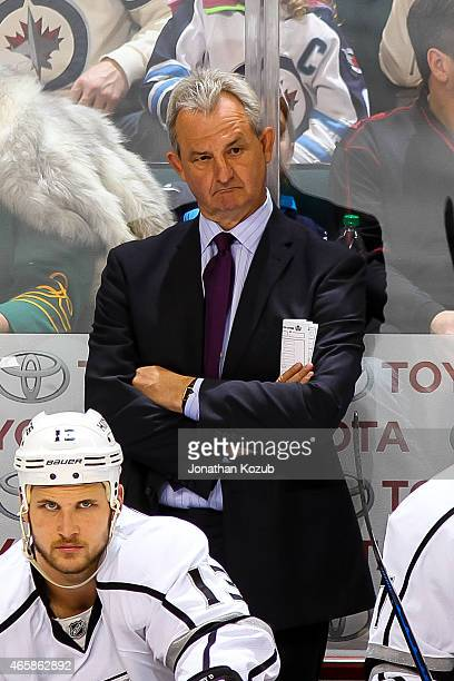 Head Coach Darryl Sutter of the Los Angeles Kings looks on from the bench during third period action against the Winnipeg Jets on March 1 2015 at the...