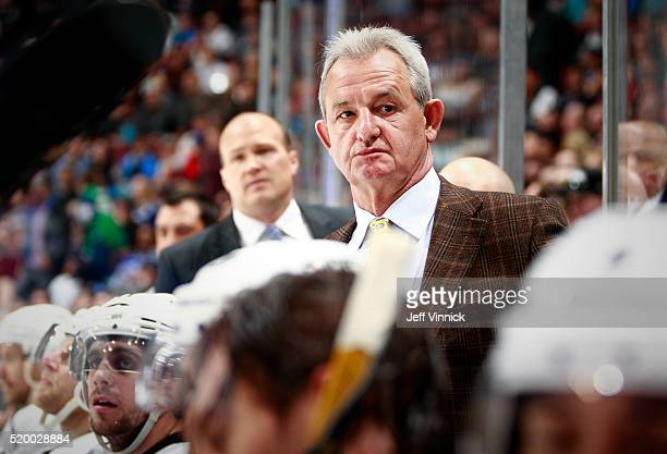 Head coach Darryl Sutter of the Los Angeles Kings looks on from the bench during their NHL game against the Vancouver Canucks at Rogers Arena April 4...