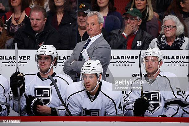 Head coach Darryl Sutter of the Los Angeles Kings on the bench during the NHL game against the Arizona Coyotes at Gila River Arena on December 26...