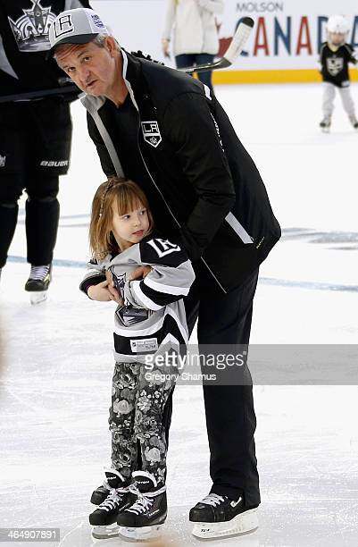 Head coach Darryl Sutter of the Los Angeles Kings skates with his granddaughter McKenzie during the family skate after the team practice for the 2014...