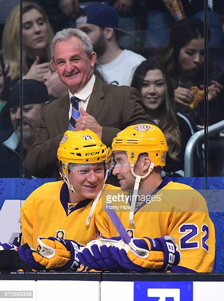 Head Coach Darryl Sutter of the Los Angeles Kings smiles behind Tyler Toffoli and Trevor Lewis before the game against the Calgary Flames at Staples...