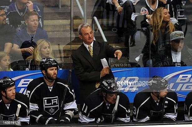Head Coach Darryl Sutter of the Los Angeles Kings stands on the bench during the game against the Vancouver Canucks in Game Four of the Western...