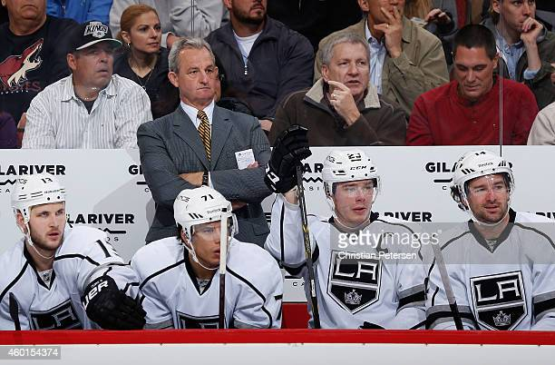 Head coach Darryl Sutter of the Los Angeles Kings watches from the bench during the first period of the NHL game against the Arizona Coyotes at Gila...