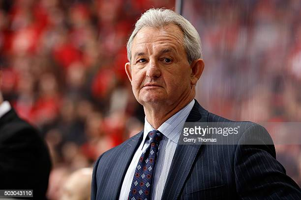 Head coach Darryl Sutter of the Los Angeles Kings watches the game against the Calgary Flames during an NHL game at Scotiabank Saddledome on December...