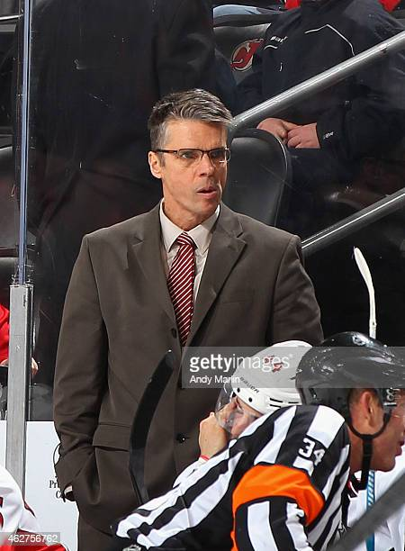 Head coach Dave Cameron of the Ottawa Senators looks on during the game against the New Jersey Devils at the Prudential Center on February 3 2015 in...