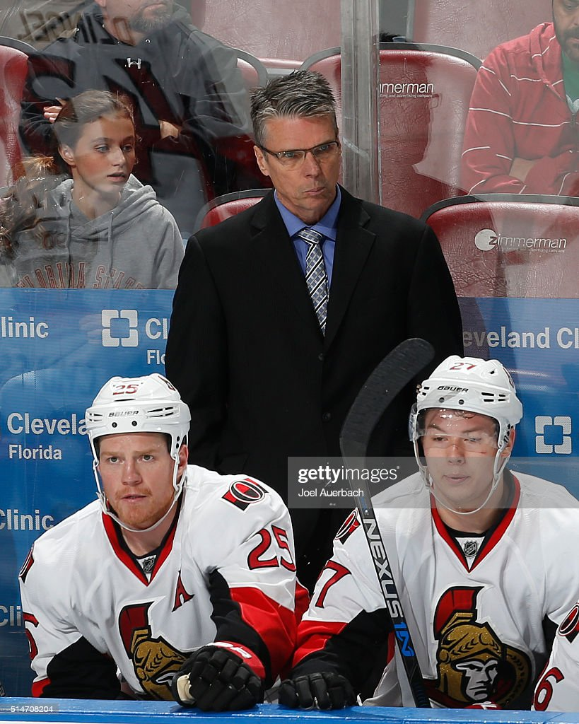 Head coach Dave Cameron of the Ottawa Senators looks on during third period action against the Florida Panthers at the BB&T Center on March 10, 2016 in Sunrise, Florida. The Panthers defeated the Senators 6-2.