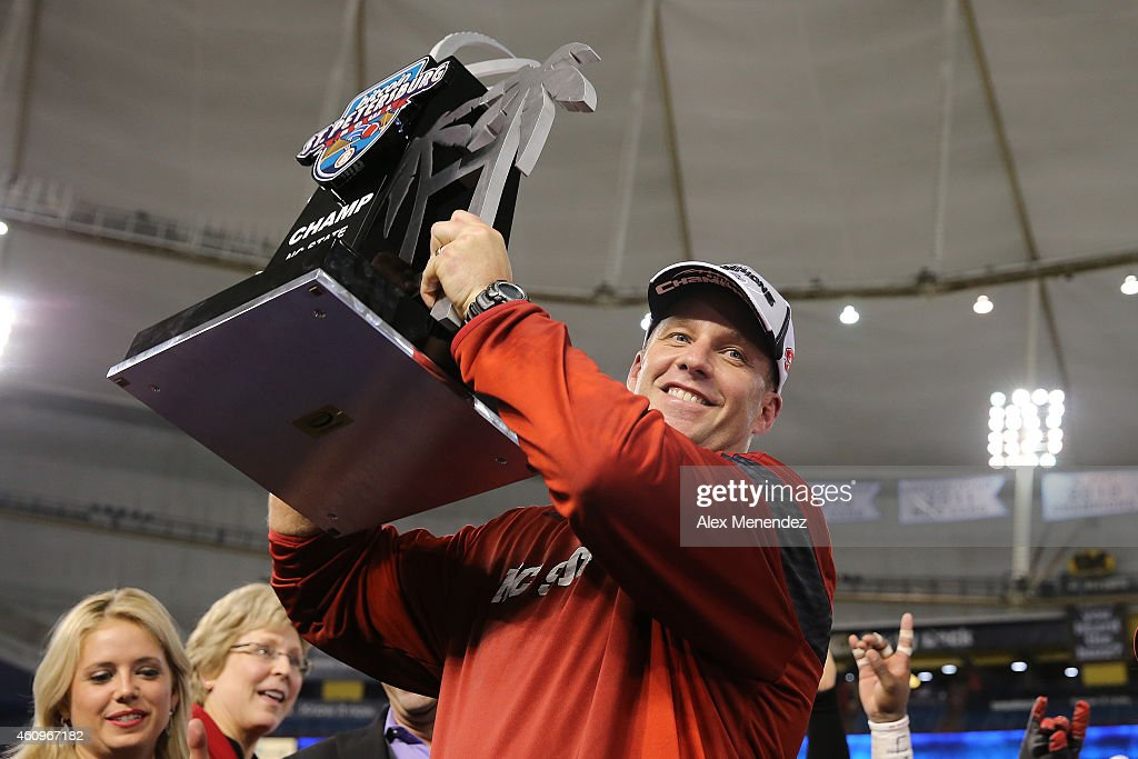 Head coach <a gi-track='captionPersonalityLinkClicked' href=/galleries/search?phrase=Dave+Doeren&family=editorial&specificpeople=3913248 ng-click='$event.stopPropagation()'>Dave Doeren</a> of the North Carolina State Wolfpack celebrates after winning the NCAA Bitcoin St Petersburg bowl against the UCF Knights by a score of 34-27 at Tropicana Field on December 26, 2014 in St. Petersburg, Florida.