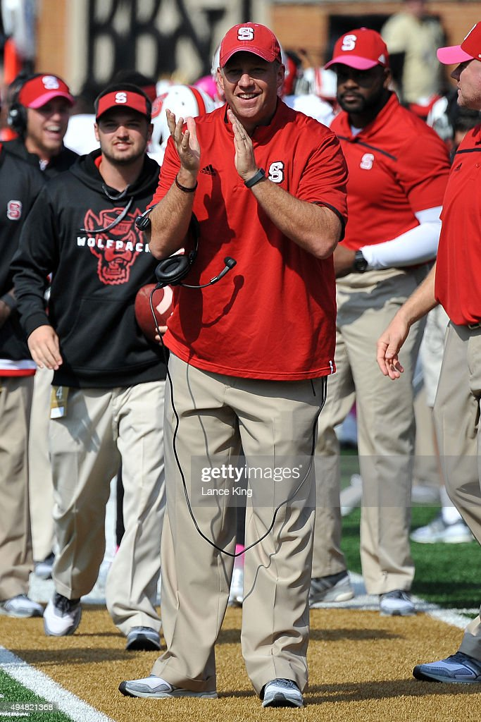 Head Coach <a gi-track='captionPersonalityLinkClicked' href=/galleries/search?phrase=Dave+Doeren&family=editorial&specificpeople=3913248 ng-click='$event.stopPropagation()'>Dave Doeren</a> of the North Carolina State Wolfpack celebrates from the sideline during their game against the Wake Forest Demon Deacons at BB&T Field on October 24, 2015 in Winston-Salem, North Carolina. NC State defeated Wake Forest 35-17.