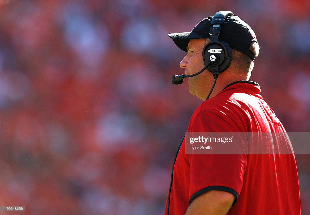 Head coach <a gi-track='captionPersonalityLinkClicked' href=/galleries/search?phrase=Dave+Doeren&family=editorial&specificpeople=3913248 ng-click='$event.stopPropagation()'>Dave Doeren</a> of the North Carolina State Wolfpack looks on during the game against the Clemson Tigers at Memorial Stadium on October 4, 2014 in Clemson, South Carolina.