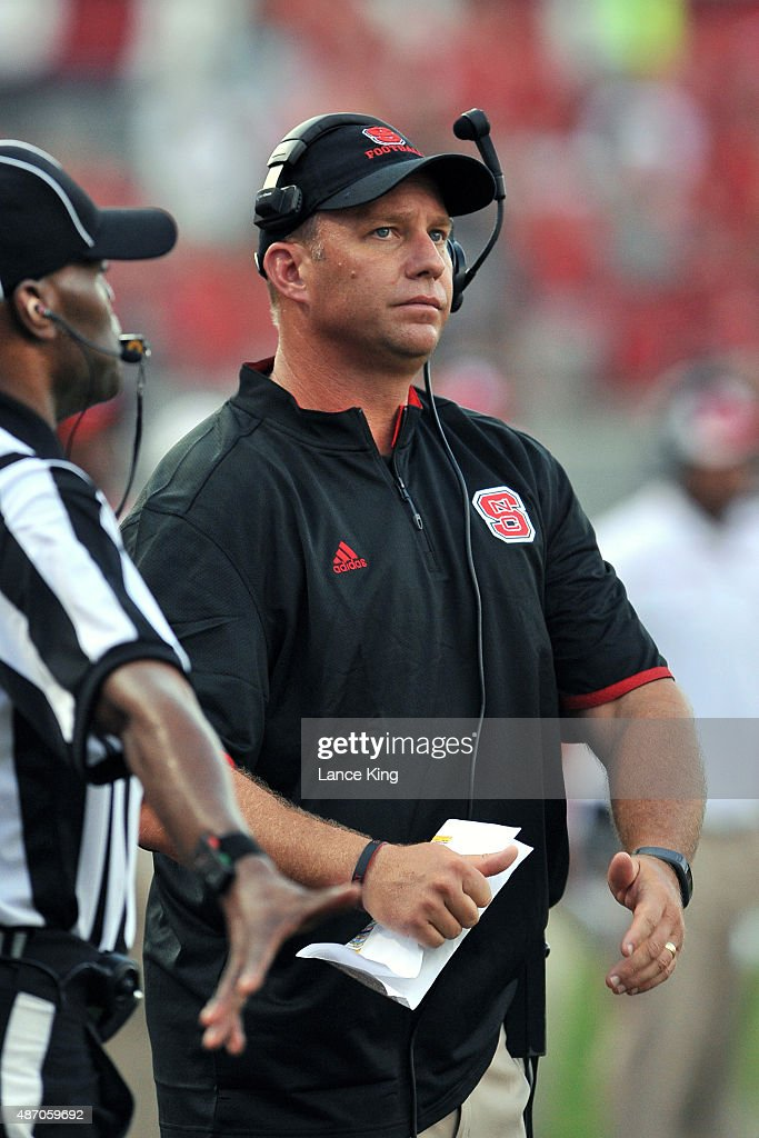 Head Coach <a gi-track='captionPersonalityLinkClicked' href=/galleries/search?phrase=Dave+Doeren&family=editorial&specificpeople=3913248 ng-click='$event.stopPropagation()'>Dave Doeren</a> of the North Carolina State Wolfpack looks on during their game against the Troy Trojans at Carter-Finley Stadium on September 5, 2015 in Raleigh, North Carolina.