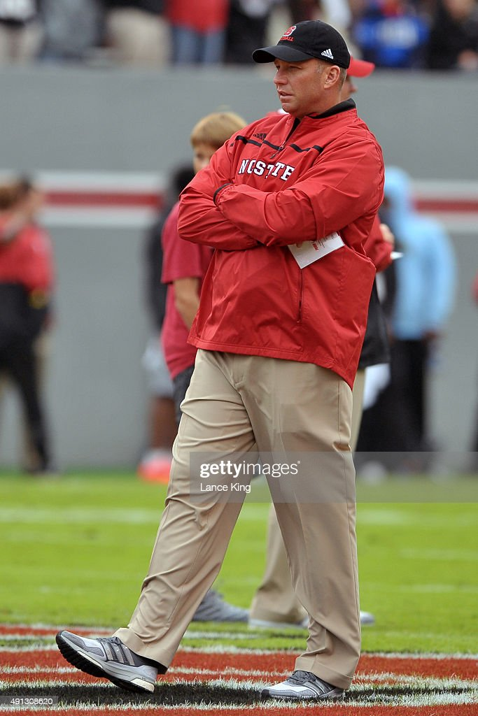 Head Coach <a gi-track='captionPersonalityLinkClicked' href=/galleries/search?phrase=Dave+Doeren&family=editorial&specificpeople=3913248 ng-click='$event.stopPropagation()'>Dave Doeren</a> of the North Carolina State Wolfpack looks on prior to a game against the Louisville Cardinals at Carter-Finley Stadium on October 3, 2015 in Raleigh, North Carolina. Louisville defeated NC State 20-13.