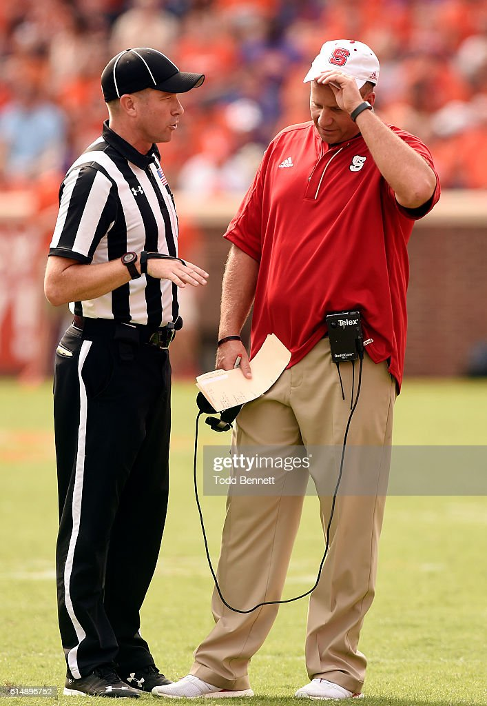 Head coach Dave Doeren of the North Carolina State Wolfpack reacts as he talks to an official during a timeout in their game against the Clemson Tigers on October 15, 2016 at Memorial Stadium in Clemson, South Carolina.