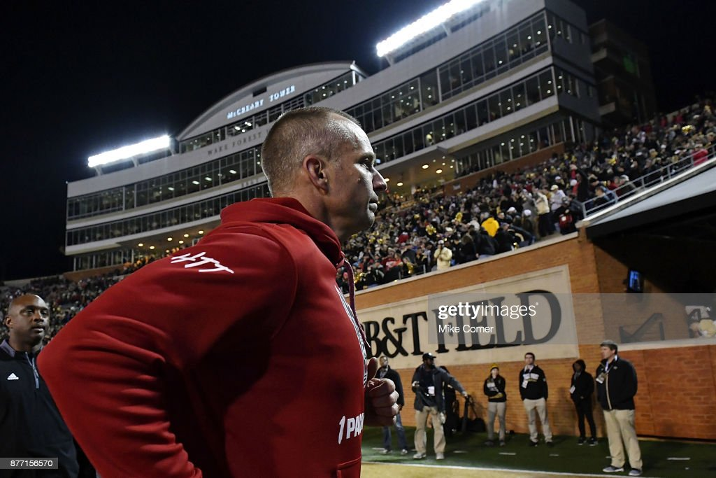 Head coach Dave Doeren of the North Carolina State Wolfpack runs off the field after the Wolfpack's loss in the football game against the Wake Forest Demon Deacons at BB&T Field on November 18, 2017 in Winston Salem, North Carolina.