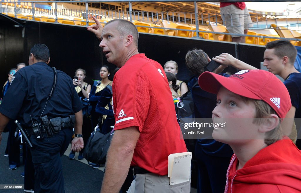 Head Coach Dave Doeren of the North Carolina State Wolfpack waves to the crowd as he leaves the field following the North Carolina State Wolfpack 35-17 win over the Pittsburgh Panthers at Heinz Field on October 14, 2017 in Pittsburgh, Pennsylvania.