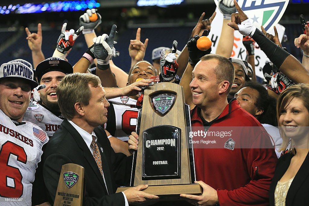 Head coach Dave Doeren of the Northern Illinois Huskies is presented the championship trophy by MAC Commissioner, Dr. Jon A. Steinbrecher after defeating the Kent State Golden Flashes 44-37 during the Mid-American Conference Championship game at Ford Field on November 30, 2012 in Detroit, Michigan.