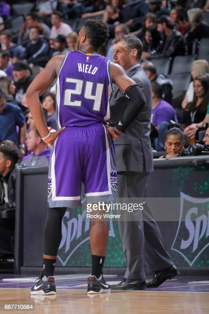 Head coach Dave Joerger of the Sacramento Kings coaches Buddy Hield against the Houston Rockets on April 9 2017 at Golden 1 Center in Sacramento...