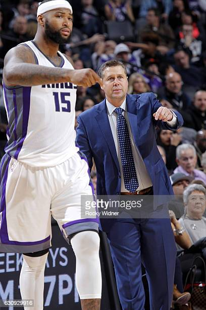 Head coach Dave Joerger of the Sacramento Kings coaches DeMarcus Cousins against the Philadelphia 76ers on December 26 2016 at Golden 1 Center in...
