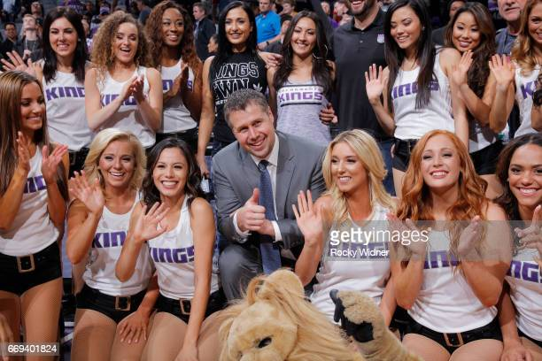 Head coach Dave Joerger of the Sacramento Kings poses for a photo with the Sacramento Kings dance team after the game against the Phoenix Suns on...