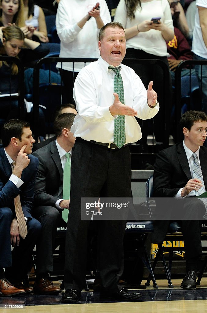 Head coach Dave Paulsen of the George Mason Patriots watches the game against the George Washington Colonials at the Charles E Smith Athletic Center...