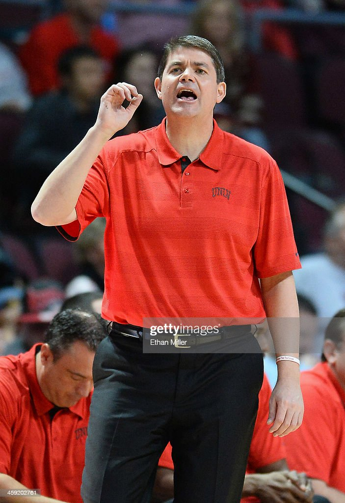 Head coach Dave Rice of the UNLV Rebels yells to his players as they take on the Mississippi State Bulldogs during the 2013 Continental Tire Las Vegas Classic at the Orleans Arena on December 23, 2013 in Las Vegas, Nevada. UNLV won 82-66.